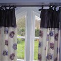 Trimmed tie top curtains